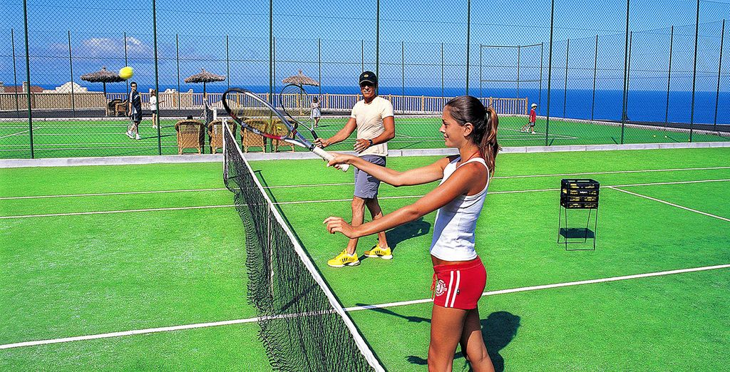 Challenge your partner to a game of tennis