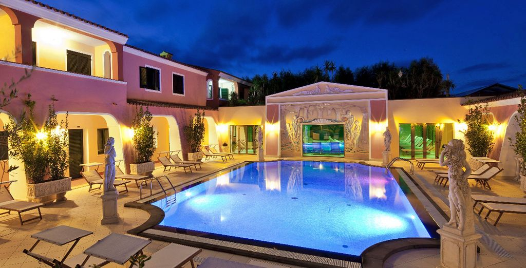 A pool that transforms into a romantic setting at night