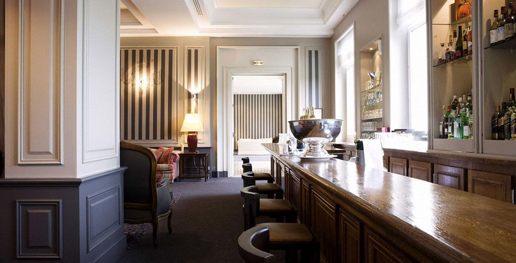 Relax with a drink at the elegant hotel bar...