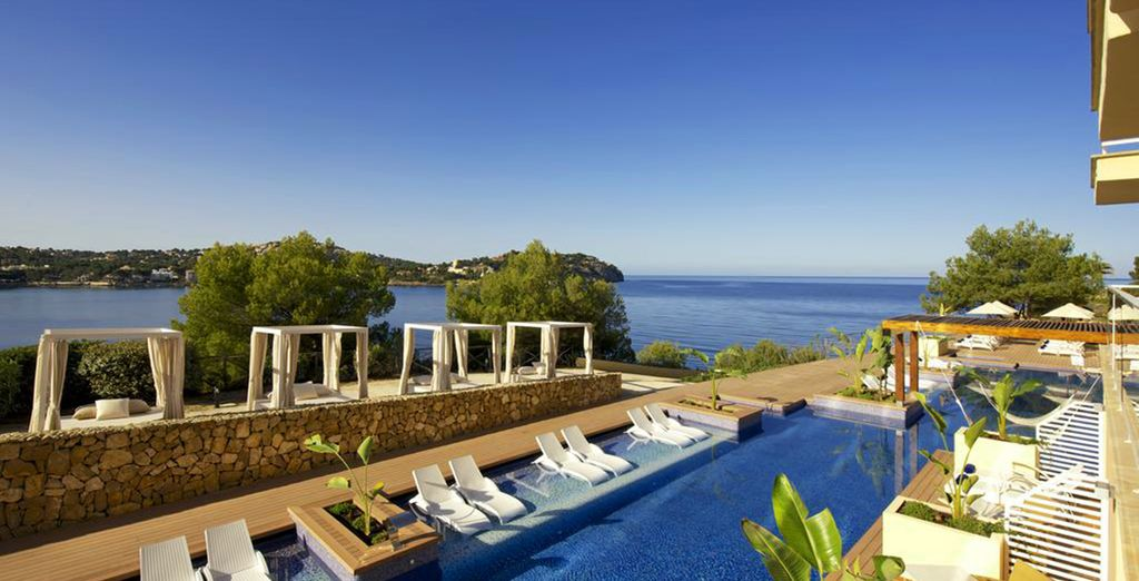 Dip your feet in the pool while admiring a magnificent ocean view