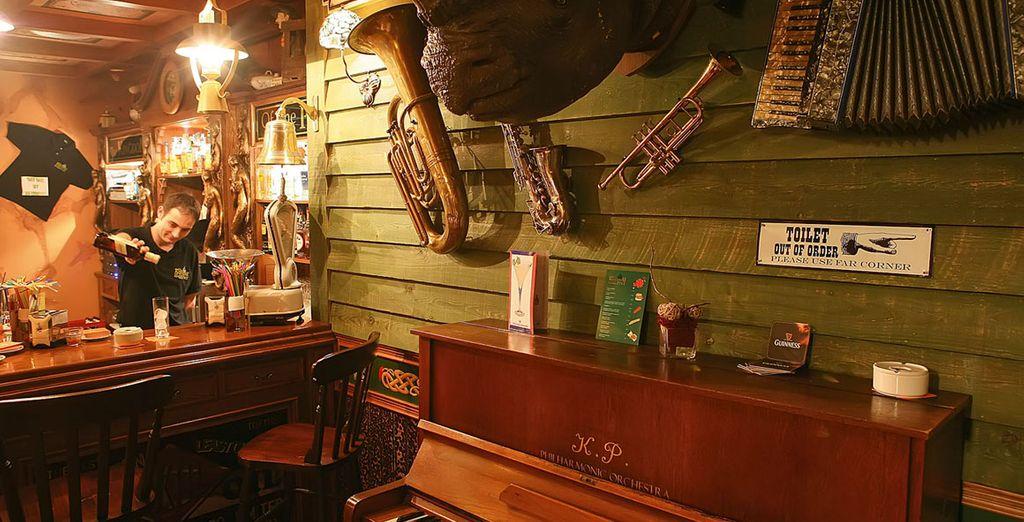 Unwind in the bar as night falls