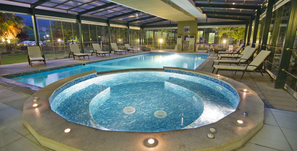 Unwind in the softly lit indoor pool with sensual Jacuzzi